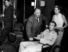 Alfred Hitchcock, James Stewart and Grace Kelly on set of Rear Window.