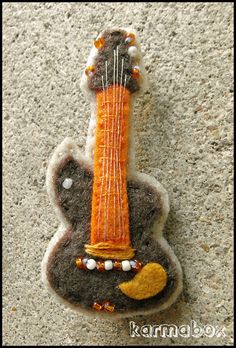 Electric Guitar Felt Fuzzies - Now in shades of warm brown and copper. Handmade felt hair clips and pins for all ages.