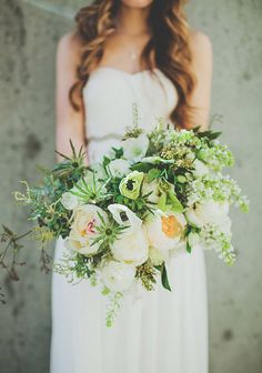 Idea of a bridal bouquet that is mostly ivory and cream but holds a punch with the thistle (similar texture to cactus)