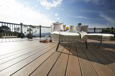 As a premium hardwood, Ipe decking promises enduring beauty, but in terms of performance and sustainability, TimberTech composite decking wins out. Outdoor Sofa, Outdoor Spaces, Outdoor Living, Outdoor Decor, Porches, Timbertech Decking, Deck Maintenance, Deck Builders, Deck Railings
