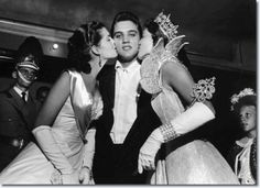 Maid of Cotton Patricia Cowden (left) and Memphis Cotton Carnival Queen Clare Mallory gave Elvis Presley royal kisses just before he walked on stage before a packed Ellis Auditorium audience on the night of May 15, 1956.