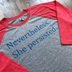 She was warned. She was given an explanation. Nevertheless, she persisted.  Super soft 3/4 sleeve raglan tee. Grey with red sleeve, royal blue writing on the front. Fabric: 4.3 oz. 32 singles fabric laundered for reduced shrinkage 50% polyester/25% combed ringspun cotton/25% rayon jersey  Features: 1x1 baby rib-knit set-in collar Satin label  Sizes: XS-3XL