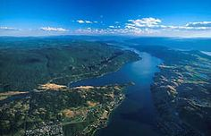 """This sightseeing tour will have you flying north over Lake Okanagan. You will search for the legendary """"OGOPOGO"""" while soaring along the vineyards and orchards around Okanagan Centre."""