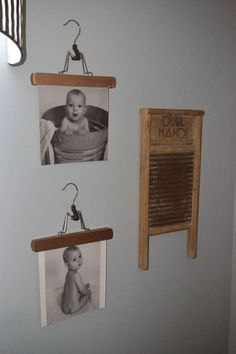 Such a cute and cheap idea!! Use pants hangers to hold pictures in the laundry room! #laundryroom #pantshangers #wallart by dionne