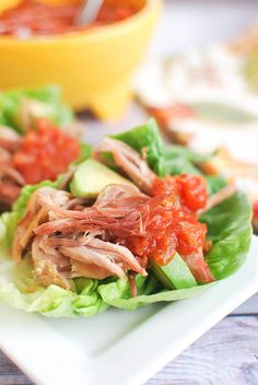 Crockpot Carnitas Lettuce Wraps - Fake Ginger these were SOOOO good and the crockpot did all the heavy lifting for me while i was at work. the crisping up at the end is a must - the texture was perfect! Pork Recipes, Slow Cooker Recipes, Paleo Recipes, Mexican Food Recipes, Crockpot Recipes, Dinner Recipes, Cooking Recipes, Mexican Dishes, Lettuce Wrap Recipes