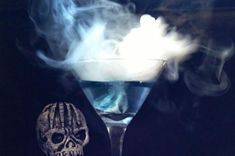 Make your annual Halloween bash the best one yet with this mesmerizing martini. Not only does it change colors, it lets off a spooky waft of white vapor. Haloween Drinks, Halloween Cocktails, Dry Ice Drinks, Cold Drinks, Beverages, Halloween Menu, Halloween Ideas, Halloween 2015, Pumpkin Carving Party