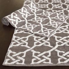 The Farrah indoor/outdoor rug is a great neutral option with a fun chainlink graphic. (5x8 - $149)