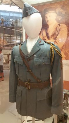 """Uniform of Edwin C. Parsons who flew with the French Volunteer American Squadron of the Lafayette Escadrille. During his time with the squadron he shot down eight German aircraft. He survived the war and was a technical advisor for Howard Huge's epic """"Hell's Angels"""" movie.  Photo by Scott Slaten"""