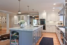 Mom likes the color of the cabinets. White Imperial Marble Design Ideas, Pictures, Remodel, and Decor