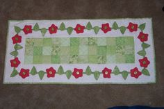 Spring table runner with 3D flowers and leaves.