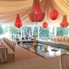 We can't decide what we love more about this dreamy design- the beaded chandeliers or the fountain inside of the reception tent. This design is proof that you can truly have it all!