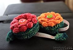 Ravelry: Ups-a-Daisy Measuring Tape pattern by Julie Tarsha....so adorable. :)