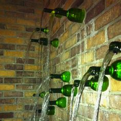 Wine bottle fountain. If only it was wine flowing out of those bottles...