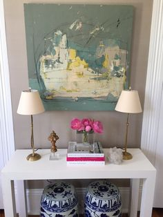 Paloma Contreras white Parsons console table with blue and white vases and modern art from Alexis Walter
