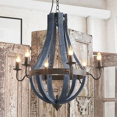 Check out Wooden Wine Barrel Stave Chandelier from Shades of Light  This is my favorite in the Navy - I thought it would tie in the island nicely from the other side of the room.  my concern is the size.  not sure if it is too tall for the space.
