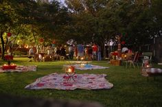 outdoor party idea. Almost everyone can't resist setting a blanket out on the lawn (or on the beach) at night... add a candle on a stand or candles on a plate.