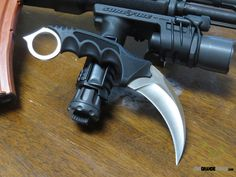 The Honshu Karambit by United Cutlery is a great, budget friendly, self defense knife. Buy one today at OsoGrandeKnives: http://www.osograndeknives.com/catalog/fixed-blade-karambits/united-cutlery-honshu-karambit-fixed-4.0-inch-satin-blade-shoulder-sheath-2977-25821.html