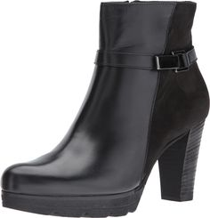 Paul Green Women's Jolie Bootie Black Combo Boot. The Jolie is a sophisticated bootie that'll elevate any ladylike ensemble. Upper made of rich leathers. Inside zipper closure. Decorative buckle strap wraps ankle. Almond toe on an ankle bootie silhouette. Smooth leather linings. Stacked chunky heel. Synthetic lug sole. Made in Austria. Measurements: Heel Height: 3 1⁄4 in Weight: 13 oz Circumference: 10 in Shaft: 6 in Product measurements were taken using size AT 5 (US Women's 7.5), width…