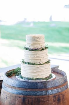 Rustic wedding cake: http://www.stylemepretty.com/2015/01/27/rustic-summer-wedding-by-the-sea/ | Photography: Wildflower Studio - http://www.wildflowerstudiophoto.com/