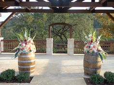 Wine Barrels with Flowers for a Rustic Elegance saweddings.com austinweddings.com