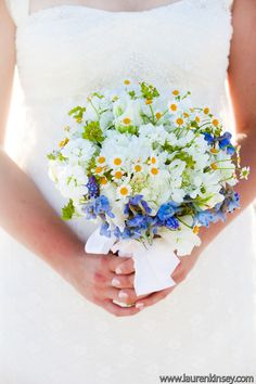 I want to incorporate daisies into my bouquet & any other floral stuff I have--my mom carried daisies at my parents' wedding.