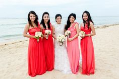 The bridesmaids looked young and fresh in asymmetrical long dresses adorned with rosettes. | www.BridalBook.ph