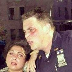 "NYPD Officer Christopher Amoroso on 9/11. After saving this woman, he went back into the WTC, & he died when he went in to save more people. ""Greater love hath no man..."""
