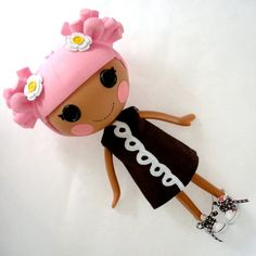 My girls would want to eat the dress off this lalaloopsy doll! :D
