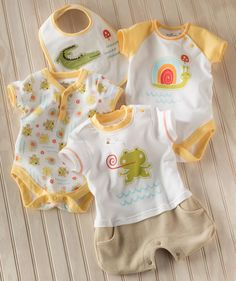 Snips & snails and puppy dog tails - and lots of love went into this sweet little collection of body suits, rompers and summer one pieces for your little guy! Exclusively from Hallmark Baby