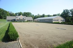 State of the Art Dressage Facility on 25 acres offers indoor and outdoor arenas. Ride on 1000 acres of adjacent trails. Live above 12 stall barn in lovely 2BR apt.