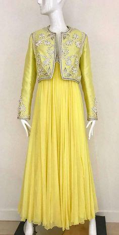 c6a49fe356 For Sale on 1stdibs - Vintage 1960s Sylvia Nechis Yellow Silk Chiffon  sleeveless V neck Soutache