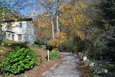 Mountain pass and old house near Lecco in Italy in autumn sunny day Royalty Free Stock Photos
