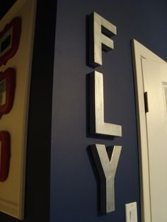 Love the way these letters pop against the navy walls! Perfect for an airplane nursery.