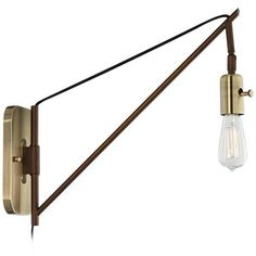 Clean lines and a simple design creates a modern look in this adjustable wall sconce.