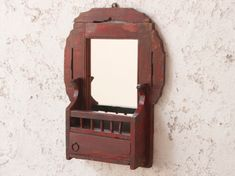 A striking ornate wall shaving mirror with its original red faded painted finish. It also has a small lower storage areas. #vintage #furniture #sale #vintagefurniture Storage Area, Cupboard Storage, Storage Cabinets, Furniture Sale, Vintage Furniture, Leather Accessories, Magazine Rack, Mirror, Interior