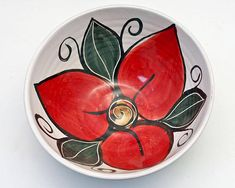 Holiday decoration that can be use year round. Hand thrown from red earthenware pottery clay and majolica glazed in my red trillium flower pattern, my medium pottery serving bowl is sure to please! The red flower sets on a white background complete with green leaves and small