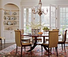 This could be a Morning Room or a Dining Room in this house - with the expansive windows and all the light, it looks more like a Morning Room to me, but the built-in curio-style shelving suggest a Dining Room.