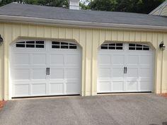 Haas model 660 Steel Carriage House Style Garage Doors in White with Arch 6 Pane Glass & Flat Black Spade Handles. Installed by Mortland Overhead Door. mortlanddoor.com