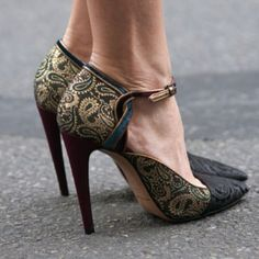 I'd wear this if the heel were a bit shorter.  Very nice shoe.  Interesting pattern.