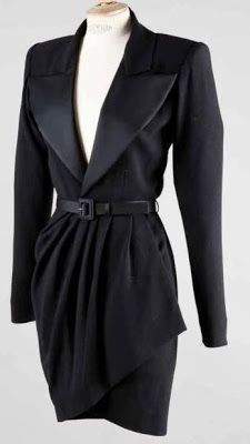 YSL Haute-couture No. 64260 Fall - Winter 1988/1989. Dress tuxedo black wool crepe, lapel notched satin shawl collar on neck edge, long sleeves, straight skirt effect asymmetric portfolio embellished with pleats.