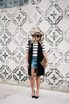 Panama Hat, Striped Tee, Denim Cutoff Shorts, Long Black Vest, Black Pumps, Leopard Clutch // @bowsandsequins