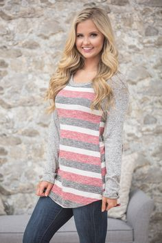 This sweet striped blouse is calling your name!