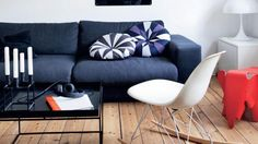 Via Femina | Blue Couch | Red Eames Elephant and White Rocker