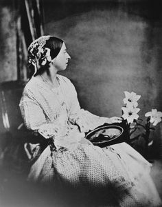1889 copy of a photograph taken on July Queen Victoria holds a photograph of Prince Albert on her lap.