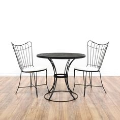 This patio set is featured in a shiny brushed black steel. This Mid Century modern set has 2 wire chairs, round mesh top table, and upholstered white seats. A sleek and stylish set that's perfect for outdoor dining! #midcenturymodern #tables #diningset #sandiegovintage #vintagefurniture