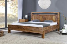 Bett BALI Sheesham 180x200cm Das riesige Massivholzbett BALI aus dem Edel-Holz Sheesham überzeugt durch eine grosse Liegefläche in 180*200cm und einer Liegeflächenhöhe von 40cm. Das Doppelbett BALI wirkt durch seine schlichte und natürliche Eleganz und ist ein Bett für Alle die das Besondere mögen. Bei dem Massivholzbett BALI handelt es sich um Handarbeit und um ein Naturprodukt. Hierbei kann es zu Farbabweichungen oder Unebenheiten kommen. Breite: 200 cm Höhe: 220 cm Höhe des Kopfteils: 105…