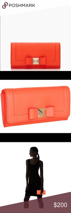 """kate spade • bow terrace cindy wallet condition: new with tags retail: $228 plus tax  - color: maraschino - Bow with a pyramid stud center - Cowhide leather - 14-karat light gold plated hardware - Metallic jacquard lining with spades - Envelope wallet with flap and magnetic closure - Top flap has snap closure - Back slip pocket on outside - Slots for six credit cards, two billfolds and a zipper change compartment - 7.5""""L x 1.25""""H x 4""""W  NO TRADES  trusted seller for years • ships quickly…"""