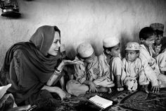 Angelina Jolie in Afghanistan. The photographer Marco Di Lauro, he covered in Afghanistan the trip of Angelina Jolie as UNHCR goodwill ambassador (United Nations High Commissioner for Refugees).