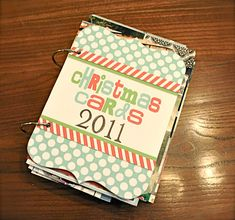How to make a Christmas cards memory book. I hate throwing out all the cute Christmas cards I get each year. Since most of them have pictures, this is a great way to display and save them!
