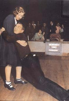 Last couple standing during a dance marathon, 1930, Merry Gardens Dance Hall (across the street from the Vic), Chicago.